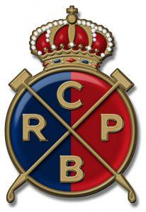 Escut del Real Club de Polo de Barcelona. A la fotografia destacada, vista general de les instal·lacions, el juny de 1915.  Fotografia: Frederic Ballell -  Arxiu Fotogràfic de Barcelona (AFB)
